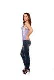 Ragazza teenager in jeans lacerati. Isolato su bianco Fotografie Stock Libere da Diritti
