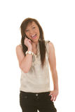 Ragazza teenager sulla risata del cellulare Fotografie Stock Libere da Diritti