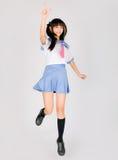 Ragazza teenager sveglia giapponese del banco Fotografia Stock
