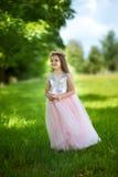 Ragazza in un bello vestito Fotografie Stock