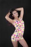 Ragazza in un breve vestito Fotografia Stock
