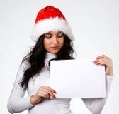 Ragazza in un cappello del Babbo Natale Fotografie Stock Libere da Diritti