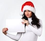 Ragazza in un cappello del Babbo Natale Fotografie Stock