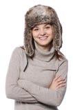Ragazza in un cappello di inverno su bianco fotografia stock