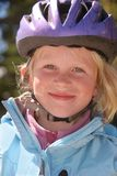 Ragazza in un casco della bicicletta Immagine Stock Libera da Diritti