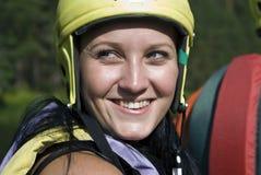 Ragazza in un casco protettivo ed in un giubbotto di salvataggio Fotografia Stock Libera da Diritti
