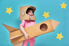 Ragazza in un costume dell'astronauta Fotografia Stock