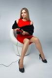Ragazza in un gioco rosso del vestito Fotografia Stock Libera da Diritti