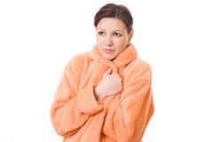 Ragazza in un grembiule arancione Fotografie Stock Libere da Diritti