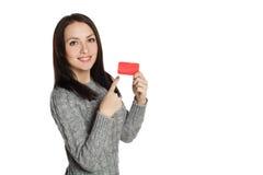 Ragazza in un maglione con sorridere della carta Fotografia Stock Libera da Diritti