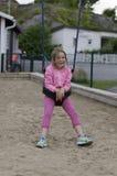 Ragazza in un'oscillazione del bambino Fotografia Stock