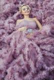 Ragazza in un sorridere rosa del vestito Immagine Stock Libera da Diritti