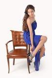 Ragazza in un vestito blu Fotografia Stock
