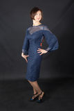 Ragazza in un vestito blu Immagine Stock