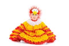 Ragazza in un vestito del pollo Immagini Stock