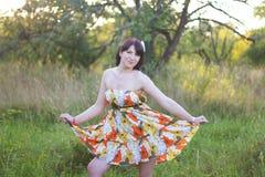 Ragazza in un vestito luminoso Fotografia Stock Libera da Diritti
