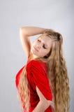 Ragazza in un vestito rosso Immagini Stock Libere da Diritti