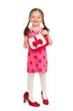 Ragazza in un vestito rosso Colpo dello studio Immagini Stock