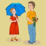 Ragazza in un vestito rosso sotto l'ombrello ed il ragazzo in una maglietta gialla w Fotografie Stock