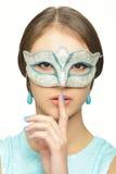 Ragazza in una maschera di carnevale Fotografie Stock