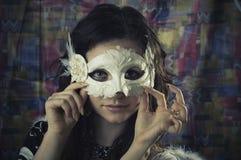 Ragazza in una mascherina Fotografia Stock
