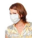 Ragazza in una mascherina medica Fotografia Stock
