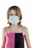Ragazza in una mascherina protettiva Immagini Stock