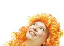Ragazza in una parrucca luminosa Fotografia Stock