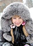 Ragazza in una pelliccia ed in un cappello Fotografie Stock Libere da Diritti