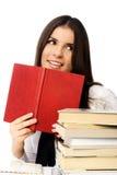 Ragazza vaga con un libro Fotografia Stock