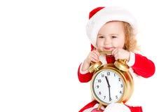 Ragazza vestita come Santa con un grande orologio Fotografia Stock