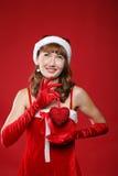 Ragazza vestita come Santa e cuore in sue mani. Fotografia Stock Libera da Diritti