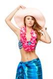 Ragazza in vestiti per la posa hawaiana del partito Fotografia Stock