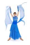 Ragazza in vestito blu che propone nello studio Fotografia Stock
