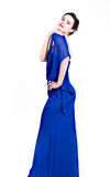 Ragazza in vestito blu che sembra sexy Immagine Stock
