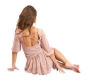 Ragazza in vestito di seta. Isolato su bianco Fotografia Stock