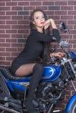 Ragazza in vestito nero su un motociclo Immagine Stock Libera da Diritti