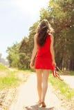 Ragazza in vestito rosso Immagini Stock Libere da Diritti