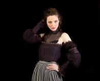 Ragazza in vestito vittoriano scuro Immagine Stock