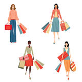 Ragazze alla moda con i sacchetti della spesa Immagini Stock Libere da Diritti