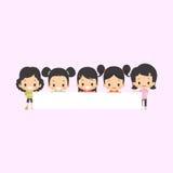 Ragazze asiatiche con l'insegna in bianco Fotografia Stock Libera da Diritti