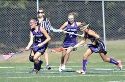 Ragazze che giocano lacrosse Fotografie Stock