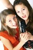 Ragazze con il microfono fotografia stock libera da diritti