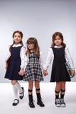 Ragazze di stile del vestito da modo dei vestiti dei bambini Fotografie Stock