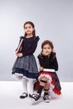 Ragazze di stile del vestito da modo dei vestiti dei bambini Fotografia Stock