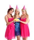 Ragazze felici che hanno una festa di compleanno Immagini Stock