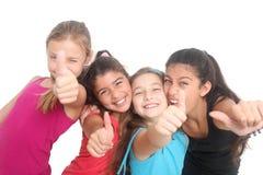 Ragazze felici che mostrano i pollici in su Fotografie Stock