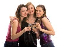 Ragazze graziose che celebrano. Isolato su bianco Fotografie Stock Libere da Diritti