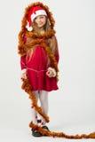 Ragazze in un vestito rosso in cappucci Santa Claus Immagine Stock
