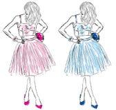 Ragazze in vestiti del figurino blu e rosa Fotografia Stock